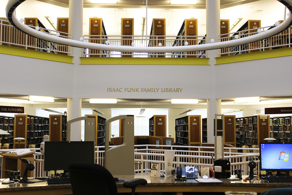 Stacks and Desk in ACES Library by IllinoisLibrary, on Flickr