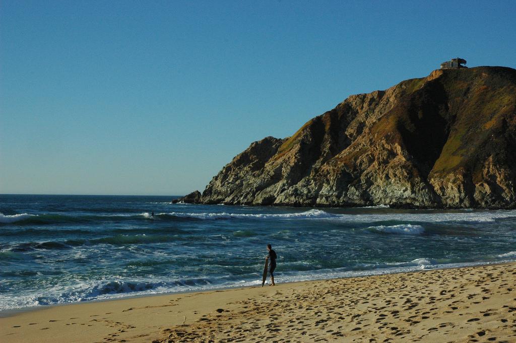 Surfers in those last few waves before s by Wonderlane, on Flickr