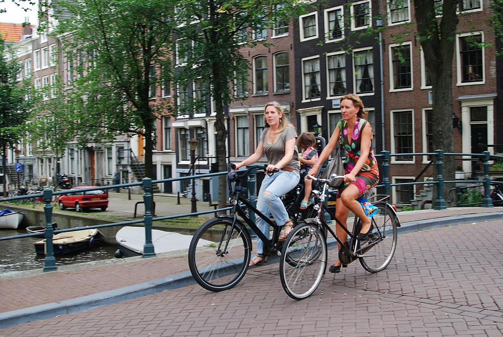 Woman with daughter on bike in Amsterdam by Sergey Galyonkin, on Flickr