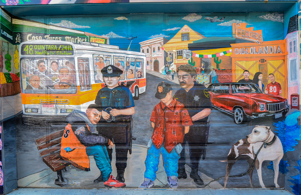 Mural: Cops and immigrants by Franco Folini, on Flickr