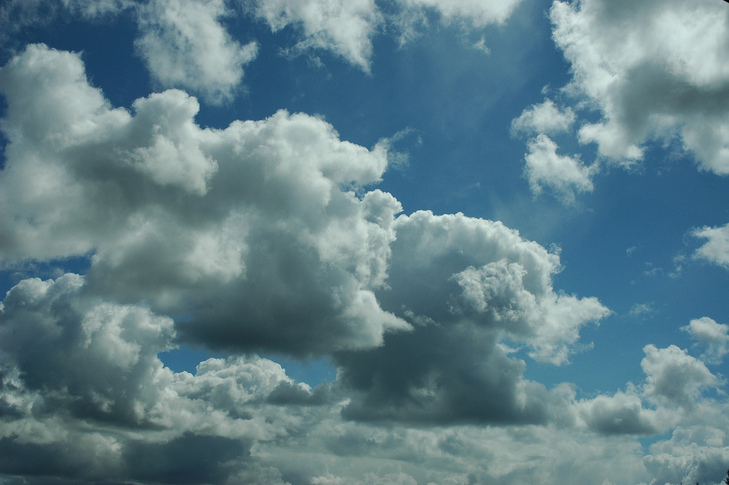 Puffy clouds loaded with rain, blue sky, by Wonderlane, on Flickr