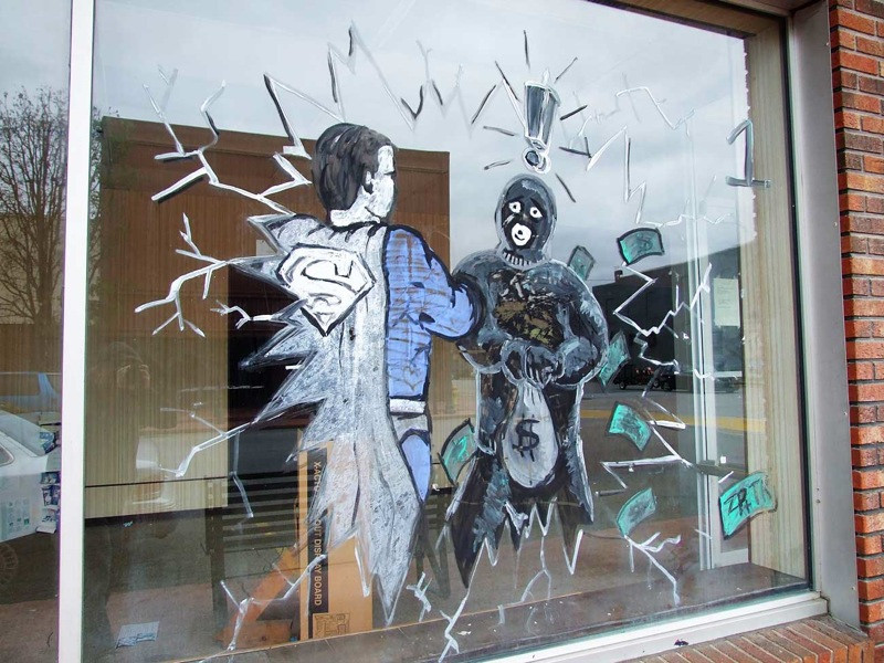 Superman beating up a bank robber by josephleenovak, on Flickr