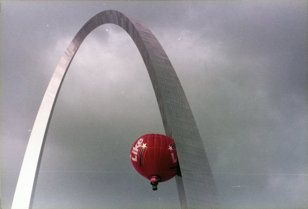 Gateway Arch and a hot air balloon durin by JNEM Archives, on Flickr